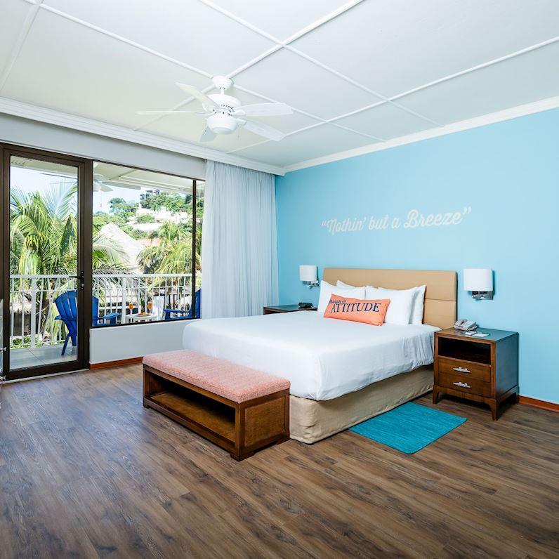 Suite con vista al mar con una cama tipo King